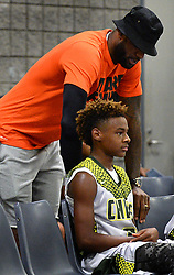 July 21, 2017 - Charlotte, NC, USA - NBA star LeBron James, left, checks on his son, LeBron Jr., after he was injured on a play during youth tournament action at the Charlotte Convention Center in Charlotte, N.C., on Friday, July 21, 2017. (Credit Image: © Jeff Siner/TNS via ZUMA Wire)