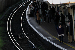 © Licensed to London News Pictures. 20/12/2011, London, UK.  Commuters wait for train on a platform at East Croydon station, south London, Tuesday, Dec. 20, 2011. Train fares will rise by an average of 5.9 percent in January 2012, the Association of Train Operating Companies has said Tuesday. Photo credit : Sang Tan/LNP