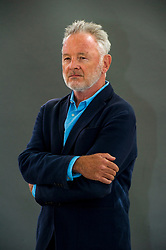 """Pictured: Robin Robertson<br /> <br /> Born in Perthshire, poet Robin Robertson was brought up on the northeast coast of Scotland where, as he says in a 2008 interview, """"history, legend and myth merged cohesively in the landscape."""" Robertson's early influences include the stories of Celtic and Classical myth, the vernacular ballads, and folklore. His deeply sensory poems explore notions of love and loss framed by the dialogue between the classical and the contemporary. Describing the poet's task, Robertson tells of the desire to reveal """"the refreshed world and, through a language thick with sound and connotation and metaphor, make some sense: some new connection between what is seen and felt and what is understood.""""<br /> <br /> Ger Harley 