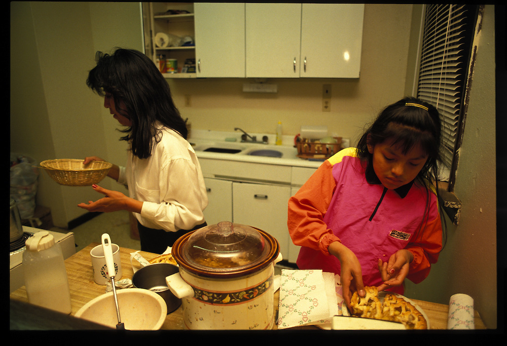 Dolly Lane and her daughter Janell in the kitchen of their Tuba City home.  Dolly, graduated from college and works for the tribe's Division of Economic Development.  Janell, who thinks she'd like to life in the city, hopes to attend Yale University and become an attorney.
