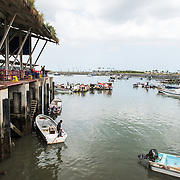 A wharf next to the seafood market on the waterfront of Panama City, Panama, on Panama Bay.