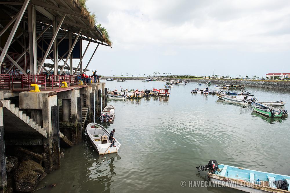 A wharf next to the seafood market on the waterfront of Panama City, Panama, on Panama Bay.