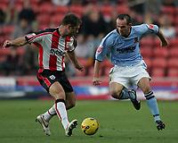 Photo: Lee Earle.<br /> Southampton v Hull City. Coca Cola Championship. 04/11/2006. Hull's Stuart Elliott (R) battles with Chris Makin.