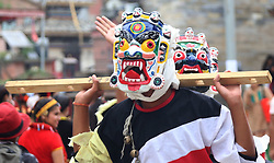 August 12, 2017 - Kathmandu, Nepal - Masked dancers from Okhaldhunga participate in the Ropain Jatra celebration organized on the occasion of Gaijatra festival. People celebrate this festival with happy joyful mood ending summer season for this year. (Credit Image: © Archana Shrestha/Pacific Press via ZUMA Wire)