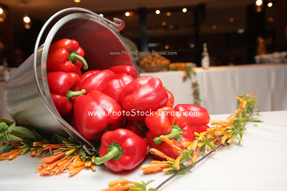 Red bell peppers as a decorative display on a table