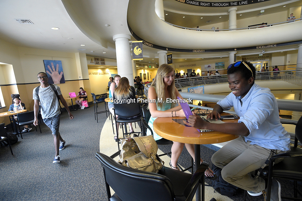 Haleigh Pool, 20, and Dayo Abioye, 21, right, relax in the student union building on the first day of classes for the fall semester at the University of Central Florida in Orlando, Fla., Monday, Aug. 24, 2015. (Photo by Phelan M. Ebenhack)