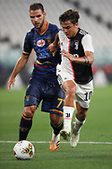 Juventus's Argentinian striker Paulo Dybala takes the ball past Lecce's Greek midfielder Panagiotis Tachtsidis during the Serie A match at Allianz Stadium, Turin. Picture date: 26th June 2020. Picture credit should read: Jonathan Moscrop/Sportimage