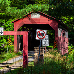 Cogan Station, PA, USA - July 14, 2011: Approach to Cogan House Covered Bridge in a remote valley in Lycoming County, PA
