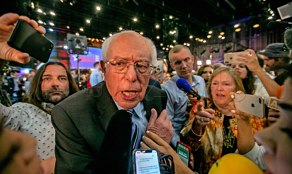 Democratic presidential candidate Sen. Bernie Sanders (I-VT) pushes through the scrum after speaking with the media at the first primary debate for the 2020 elections at the Adrienne Arsht Center for the Performing Arts in downtown Miami on Thursday, June 27, 2019.