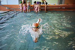 "Students participate in swimming classes at Zakladni Skola, a predominantly Roma elementary school in the neighborhood of Vitkovice in Ostrava, Czech Republic on Feb. 27, 2012. In 2000 a case was brought against the state because Roma children in the Czech Republic were 27 times more likely to be placed in ""special schools,"" intended for the mentally disabled, than non-Roma children. In 2007, the Grand Chamber of the European Court of Human Rights ruled that this pattern of segregation violated nondiscrimination protections in the European Convention on Human Rights. Despite this landmark decision, little change has occurred: the ""special schools"" have been renamed but follow the same substandard curriculum and Roma continue to be assigned to these schools in disproportionate numbers. The process of integration has barely begun."