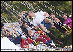 June 11, 2017 - Westonbirt, United Kingdom - Image licensed to i-Images Picture Agency. 11/06/2017. Westonbirt, United Kingdom. Mike Tindall has a go on swing ride with his daughter Mia (left) at the Gloucestershire Festival of Polo at Beaufort Polo Club in Westonbirt, Gloucestershire, United Kingdom. Picture by Stephen Lock / i-Images (Credit Image: © Stephen Lock/i-Images via ZUMA Press)