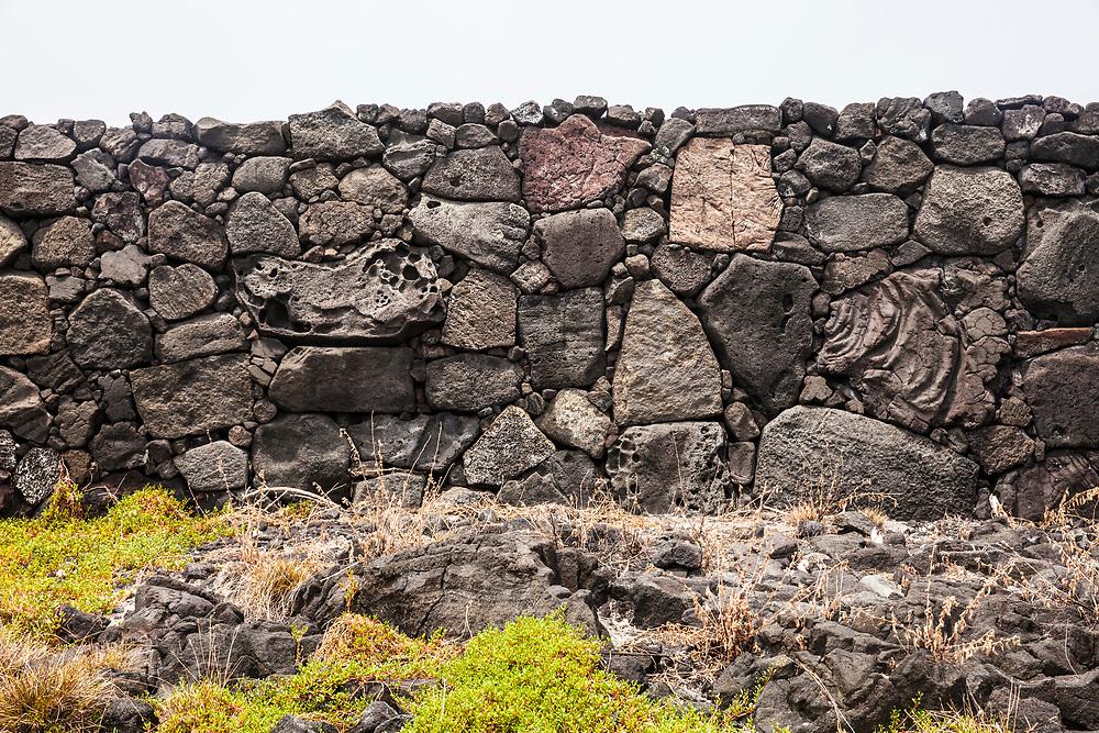 Stone walls form a platform called Ale'ale'a within Puʻuhonua o Hōnaunau National Historical Park, Hawaii, USA.