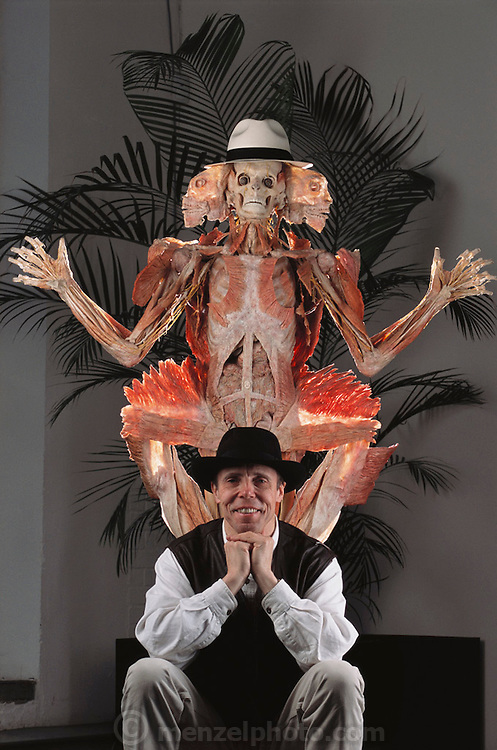 """Gunther von Hagens seen with the """"Winged Man"""" from his Body Worlds exhibit. Body Worlds is a traveling exhibit of real, plastinated human bodies and body parts. Von Hagens invented plastination as a way to preserve body tissue and is the creator of the Body Worlds exhibits.  [2002]."""
