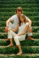 All American couple outdoors on Ivy Covered stairs