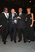 New York, NY-April 18: (L-R) Music Executive LA Reid, Music Executive Doug Morris, Rev. Al Sharpton, and Music Executive Slyvia Rhone attends Rev. Al Sharpton's National Action Network's Keeper of the Dream Awards held at Cipriani's Wall Street on April 18, 2012 in New York City. (Photo by Terrence Jennings)