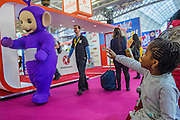 The Teletubies celebrate their 20th anniversary but dont see a young admirer - The London Toy Fair opens at Olympia exhibition centre. Organised by the British Toy and Hobby Association it is the only dedicated toy, game and hobby trade exhibition in the UK. It runs for three days, with more than 240 exhibiting companies ranging from the large internationals to the new start up companies.