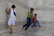 Children are playing on the fragile Markana marble of the Taj Mahal, in Agra.