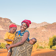 CAPTION: Velinasi has given birth to seven children, four boys and three girls. LOCATION: Nsanja-Seze, Vila Ulongwe area, Angonia District, Tete Province, Mozambique. INDIVIDUAL(S) PHOTOGRAPHED: From left to right: Trezina Dickson, Velinasi Kaliofasi and Noah Dickson.
