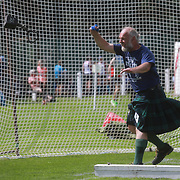 Highland Games, 3rd of August 2019, Newtonmore, Scotland, United Kingdom. Competitor Conon Quinn compete in Throwing the Weight.  The Highland Games is a traditional annual event where competitors compete as strong men, runners, dancers, pipers and at tug-of-war. The games go back centuries and are happening through-out the summer across Scotland. The games are both an important event locally and a global tourist attraction.