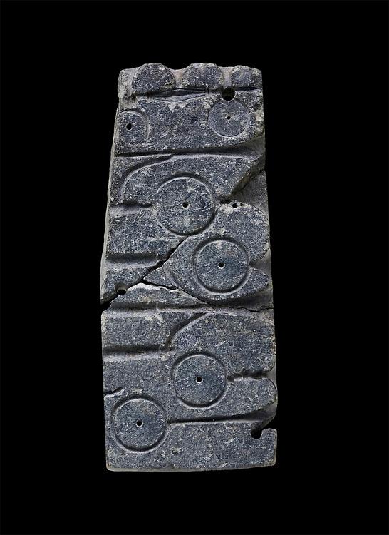 Fragment of a hittite mould from the Hittite capital Hattusa, Hittite New Kingdom 1650-1200 BC, Bogazkale archaeological Museum, Turkey. Black  background