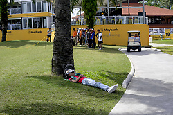 March 22, 2019 - Kuala Lumpur, Malaysia - A Spectator takes a nap on the field near to 18th hole on Day Two of the Maybank Championship at at Saujana Golf and Country Club on March 22, 2019 in Kuala Lumpur, Malaysia. (Credit Image: © Chris Jung/NurPhoto via ZUMA Press)