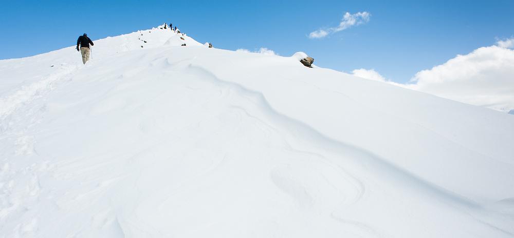 Man climbing a snowed peak in the Himalayas (Nepal)