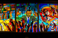"Nelson Mandela stained glass window at Regina Mundi Church, Soweto, Johannesburg, South Africa. It is the largest Roman Catholic church in South Africa. Due to the role it played as a place of gathering for the people of Soweto in the years before, during, and after the anti-apartheid struggle, it is often referred to as ""the people's church"" or ""the people's cathedral""."