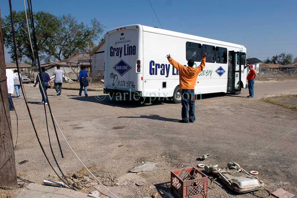 30 Oct, 2005.  New Orleans, Louisiana. Hurricane Katrina aftermath.<br /> Riding on the Gray Line bus tour for residents of the Lower 9th ward. Unlike the nearby predominantly white neighbourhoods, residents can only visit the area on special busses and are not permitted to get off the bus except at one designated location to view a 'typical' house. Photo; ©Charlie Varley/varleypix.com