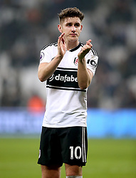Fulham's Tom Cairney applauds the fans at the end of the Premier League match at London Stadium.