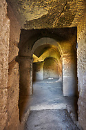"""Pictures & images of Komurlu Church interior,  9th century, the Vadisi Monastery Valley, """"Manastır Vadisi"""",  of the Ihlara Valley, Guzelyurt , Aksaray Province, Turkey.<br /> <br /> Kalburlu (St. Epthemios) church dates back to the 9th or 10th century. It is carved out of a single rock massive with rock columns holding up the roof of its church . The arches of Kalburlu (St. Epthemios) church have rich architectural decorated relif sculptures. The naves are connected by rounded arches & there is a baptismal font to the east of the main entrance. .<br /> <br /> If you prefer to buy from our ALAMY PHOTO LIBRARY  Collection visit : https://www.alamy.com/portfolio/paul-williams-funkystock/vadisi-monastery-valley-turkey.html<br /> <br /> Visit our TURKEY PHOTO COLLECTIONS for more photos to download or buy as wall art prints https://funkystock.photoshelter.com/gallery-collection/3f-Pictures-of-Turkey-Turkey-Photos-Images-Fotos/C0000U.hJWkZxAbg"""
