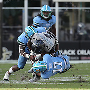ORLANDO, FL - OCTOBER 24: Running back Otis Anderson #2 of the Central Florida Knights gets stopped by defensive back Cornelius Dyson #17 of the Tulane Green Wave at Bounce House-FBC Mortgage Field on October 24, 2020 in Orlando, Florida. (Photo by Alex Menendez/Getty Images) *** Local Caption *** Otis Anderson; Cornelius Dyson