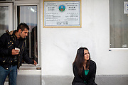 Portrait of Romina Kajtazova in front of the NGO Kham office for whom she is working as a paralegal in the city of Delcevo located in Macedonia. On the left her co worker Mershid.