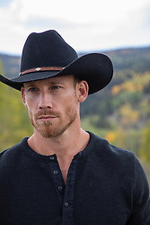 Portrait of a very handsome cowboy outdoors
