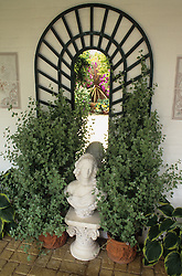 Statue and mirror in covered area