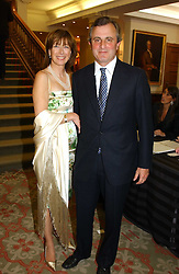 VISCOUNT & VISCOUNTESS ASTOR at '4 Inches' a project 'For Women about Women By Women' - A photographic Auction in aid of the Elton John Aids Foundation hosted by Tamara Mellon President of Jimmy Choo and Arnaud Bamberger MD of Cartier UK at Christie's, 8 King Street, London W1 on 25th May 2005.<br /><br />NON EXCLUSIVE - WORLD RIGHTS