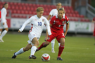 2011 FIFA Women's World Cup Qualifying match, Wales v Czech Republic at Stebonheath Park, Llanelli on Wed 23rd September 2009. pic by Andrew Orchard..Wales capt Jayne Ludlow (r) challenges Blanka Penickova (10) of Czech Republic