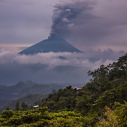 """Stratovolcano Mount Agung (Gunung Agung) is Bali's spiritual icon and the highest point on the island. It dominates the surrounding area, influencing the climate, especially rainfall patterns. <br /> * Image taken during the """"rumbling"""" of Mt. Agung. In September 2017, the area experienced 844 volcanic earthquakes, peaking at 300 to 400 earthquakes on 26 September. The frequency and intensity of these quakes caused much alarm among seismologists, as similar volcanoes have historically been known to erupt with even fewer warning signs. In late September the alert level was raised to the highest level, much of the kettle and 122,500 locals were evacuated from their houses around the volcano."""