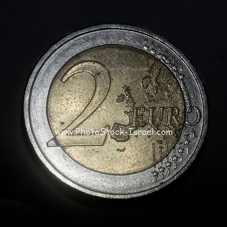 2 Euro coin on Black background