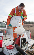 Photo Randy Vanderveen.Grande Prairie, Alberta.11-04-27.Jim Donnelly, the city of Grande Prairie pest control specialist, refills a backpack sprayer with a control agent for mosquitos. A bacteria agent attached to cornmeal is used to specifically target mosquito larvae. The control doesn't harm any other species, older mosquitoes and is dust free so a respirator and disposable coveralls are not required.