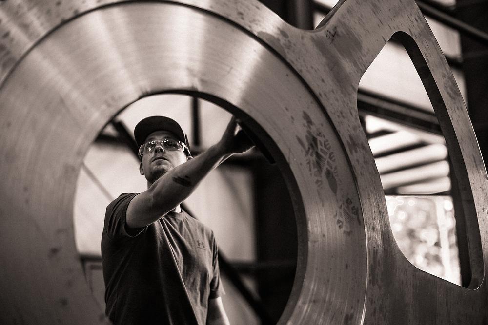 CALERA, ALABAMA –MAY 2019: Laborers work to fabricate large metal components at Davis Machine & Fabrication.