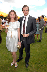 Actress RUTH WILSON and JAMES GOODSELL at the final of the Veuve Clicquot Gold Cup 2007 at Cowdray Park, West Sussex on 22nd July 2007.<br />