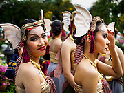 """08 APRIL 2017 - BANGKOK, THAILAND: Entertainers relax before the """"Amazing Songkran"""" festival in Benchasiri Park in Bangkok. The festival was sponsored by the Tourism Authority of Thailand to highlight the cultural aspects of Songkran. Songkran is celebrated in Thailand as the traditional New Year's Day from 13 to 16 April. Songkran is in the hottest time of the year in Thailand, at the end of the dry season and provides an excuse for people to cool off in friendly water fights that take place throughout the country. Songkran has been a national holiday since 1940, when Thailand moved the first day of the year to January 1. Songkran 2017 is expected to be more subdued than Songkran usually is because Thais are still mourning the October 2016 death of revered King Bhumibol Adulyadej.       PHOTO BY JACK KURTZ"""