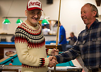 Jim O'Neil is congratulated by Peter Harris after advancing to a spot in the final championship round of the 12th annual Robbie Mills 8-Ball Tournament at the Rod and Gun on Saturday afternoon.  (Karen Bobotas/for the Laconia Daily Sun)