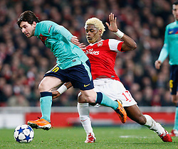 16.02.2011, Emirates Stadium, London, ENG, UEFA CL, FC Arsenal vs FC Barcelona, im Bild Barcelona's Lionel Messi and Arsenal's Alexandre Song   in Arsenal vs Barcelona for the UCL  ,Round of last 16, at the Emirates Stadium in London on 16/02/2011, EXPA Pictures © 2011, PhotoCredit: EXPA/ IPS/ Kieran Galvin +++++ ATTENTION - OUT OF ENGLAND/GBR and France/ FRA +++++