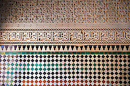 Berber Mocarabe Honeycomb work plaster decorations and Berber design tiles of the 17th century Berber Pavillion of the Ambassadors built Sultan Moulay Ismail.   A UNESCO World Heritage Site .Meknes, Meknes-Tafilalet, Morocco. .<br /> <br /> Visit our MOROCCO HISTORIC PLAXES PHOTO COLLECTIONS for more   photos  to download or buy as prints https://funkystock.photoshelter.com/gallery-collection/Morocco-Pictures-Photos-and-Images/C0000ds6t1_cvhPo<br /> .<br /> <br /> Visit our ISLAMIC HISTORICAL PLACES PHOTO COLLECTIONS for more photos to download or buy as wall art prints https://funkystock.photoshelter.com/gallery-collection/Islam-Islamic-Historic-Places-Architecture-Pictures-Images-of/C0000n7SGOHt9XWI