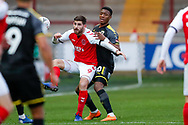 Wimbledon defender Paul Kalambayi (30) watches Fleetwood Town forward Ched Evans (9) on loan from Sheffield United,   during the The FA Cup 3rd round match between Fleetwood Town and AFC Wimbledon at the Highbury Stadium, Fleetwood, England on 5 January 2019.