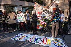 "London, April 21st 2015. Protesters demonstrate outside the Property Awards at the Grosvenor, saying that ""property developers should not be congratulating each other for the profits they have made on the back of mass gentrification in London"". London faces a severe housing shortage forkey workers and  people on low incomes, with developers snapping up housing to be replaced by expensive high-rise apoartment complexes which are out of reach for many."