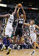 San Antonio Spurs forward Richard Jefferson (24) attempts to score as Utah Jazz center Al Jefferson (25) and Utah Jazz forward Andrei Kirilenko of Russia (47) defends during the first half of an NBA basketball game in Salt Lake City, Friday, Nov. 19, 2010. (AP Photo/Colin E Braley)