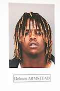 A photograph of suspect, Delmon Armstead, arrested for the murder of Mohammad Reza Sadeghzadeh, a 67-year-old Milpitas 7-Eleven night clerk who was murdered on September 8, 2012 during a 2:13 a.m. robbery, is displayed during a press conference at the Milpitas Police Department in Milpitas, California, on December 12, 2013. (Stan Olszewski/SOSKIphoto)