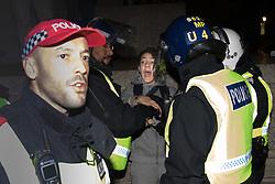London, November 5th 2016. Anti-capitalists and anarchists participate in the Million Mask March, an annual event that happens on November 5th each year in cities across the world, as part of a protest against the establishment. Many of the protesters wear Guy Fawkes masks, often associated with the internet activism group Anonymous. PICTURED: A youth is arrested after climbing off the plinth of Nelson's Column.